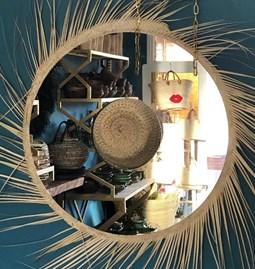 Mirror in a palm leaf hat