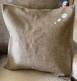 Beige embroidered cushion