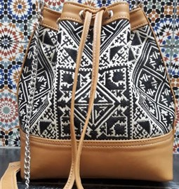 Leather and embroidered fabric bag